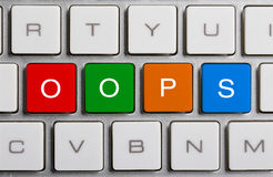 OOPS On Keyboard. OOPS text on the colorful buttons of the keyboard stock image