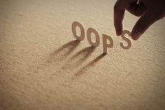OOPS wood ord på komprimerat bräde Arkivfoto