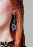 Oorring op het oor van de vrouw Royalty-vrije Stock Fotografie