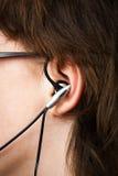 Oortelefoon in oor Royalty-vrije Stock Afbeeldingen