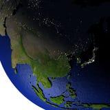 Oost-Azië bij nacht op model van Aarde met in reliëf gemaakt land Royalty-vrije Stock Foto's