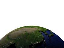 Oost-Azië bij nacht op model van Aarde met in reliëf gemaakt land Stock Afbeelding