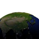 Oost-Azië bij nacht op model van Aarde met in reliëf gemaakt land Royalty-vrije Stock Fotografie