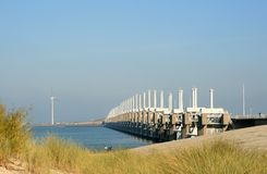 The Oosterschelde barrier. The Oosterschelde storm surge barrier is part of the Delta Works in the Netherlands. It is an open barrier, which could be closed to Royalty Free Stock Image