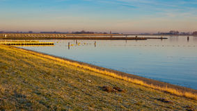 Oosterschelde lough in the low morning sun Royalty Free Stock Image
