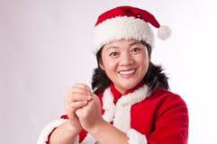 Oosterse vrouw met Kerstmishoed Stock Fotografie