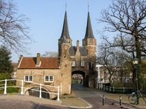 The eastern gate in Delft in Netherlands. Oostpoort in Delft. An example of Brick Gothic northern European architecture that was built around 1400. This is the Royalty Free Stock Photo