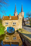 Oostpoort or Eastern Gate dome with canal and house reflection, Delft, Netherlands, Holland Stock Image