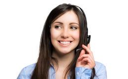 Opérateur de sourire de centre d'appels d'isolement sur le blanc photographie stock libre de droits