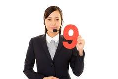 Opérateur de sourire de centre d'attention téléphonique Images libres de droits