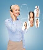 Opérateur de sourire de service d'assistance de femme Image libre de droits