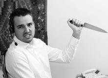 Opérateur de téléphone avec le couteau Photo libre de droits
