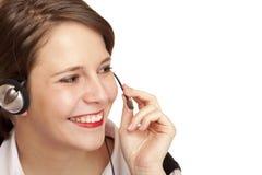 Opérateur féminin de centre d'attention téléphonique appelant amical Photographie stock libre de droits