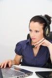 Opérateur féminin de support à la clientèle avec l'écouteur Photos stock