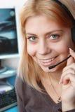 Opérateur intelligent d'Appeler-centre de sourire photographie stock