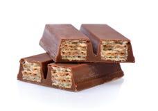 Opłatki w czekoladzie odizolowywającej na białym tle obrazy royalty free