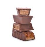 Opłatki w czekoladzie odizolowywającej na bielu obrazy royalty free