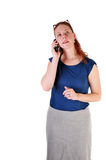Op de telefoon Stock Foto
