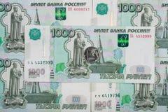 Op duizendste Russische roebels is het bankbiljet één roebelmuntstuk Stock Afbeelding