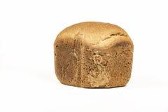 Op een witte achtergrond een brood van wit brood Royalty-vrije Stock Foto