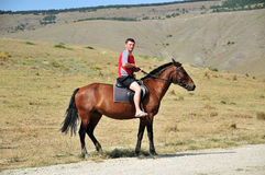 Op het paard Royalty-vrije Stock Afbeeldingen