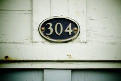 304 op plaque Royalty-vrije Stock Foto's
