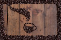 Op view Coffee beans arranged in a coffee cup.  Royalty Free Stock Photography