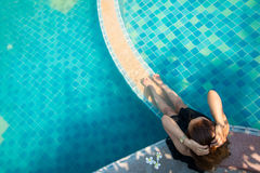 Op View Young woman Living. By the pool in the morning in the summer Royalty Free Stock Images