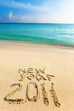 Op zand bij oceaanrand wordt het geschreven 2011 Royalty-vrije Stock Fotografie