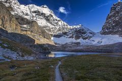 Opabin Lake in Yoho National Park Canadian Rockies. Scenic Distant Landscape View of Snowy Mountain Hungabee Top and Opabin Alpine Lake from Great Hiking Trail Royalty Free Stock Image