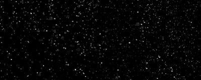 Opad śniegu odizolowywający na czarnym tle obrazy stock