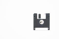 Opadającego dyska przechowywania danych magnesowy komputerowy poparcie na bielu Zdjęcia Royalty Free