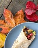 Opakunek z kolorowymi jesień liśćmi obraz royalty free