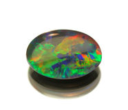 Opal. The opal black isolated on white.Cabochon royalty free stock images