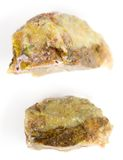 Opal a brownish-yellow color on a white background. Royalty Free Stock Photo