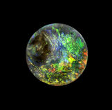 Opal gem stone round. Unique, colorful Australian black opal stock photography