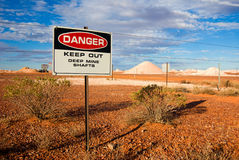 Opal Mining. Warning signs on Opal Fields near Coober Pedy in outback South Australia stock photos