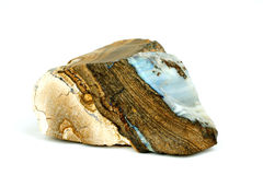Opal in original rock. Blue and white Australian Opal gem in original rock stock photography
