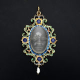 Opal Pendant. Jeweled pendant with large opal in the shape of a face Stock Photos