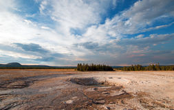 Opal Pool under cloudscape in the Midway Geyser Basin in Yellowstone National Park in Wyoming Royalty Free Stock Photography