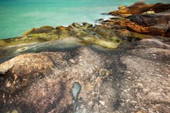 Opal waterponds on granite rocks Stock Photos