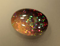 Opala natural Welo da jogo--cor do fogo Imagens de Stock