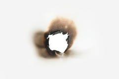 Oparzenie dziura w papierze obrazy stock