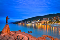 Opatija by night with girl with Seagull. Night scene of Opatija with girl with Seagull from lungomare walk Stock Photos