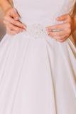 Opatrunkowa piękna ślubna suknia dalej przed małżeństwo ceremonią Obraz Royalty Free