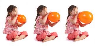 Opblazen een Ballon Stock Afbeeldingen