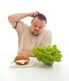 Opciones de la dieta - sanas o malsanas Foto de archivo libre de regalías