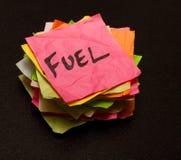 Opciones de la vida - gastar dinero en el combustible Imágenes de archivo libres de regalías