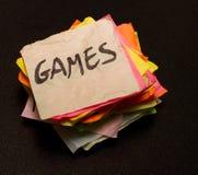 Opciones de la vida - gastar dinero en juegos Foto de archivo