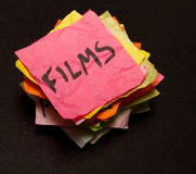 Opciones de la vida - gastar dinero en las películas Fotografía de archivo libre de regalías
